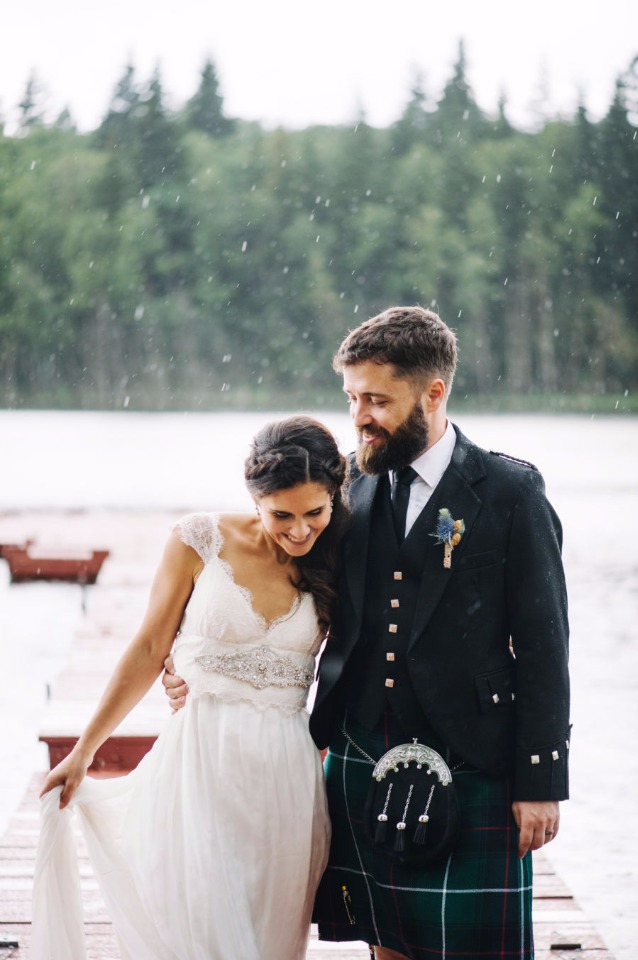 happy wedding couple in the rain
