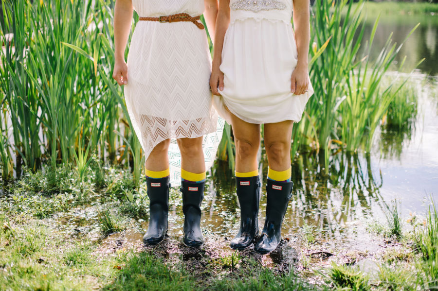 bride and bridesmaid in matching rain boots