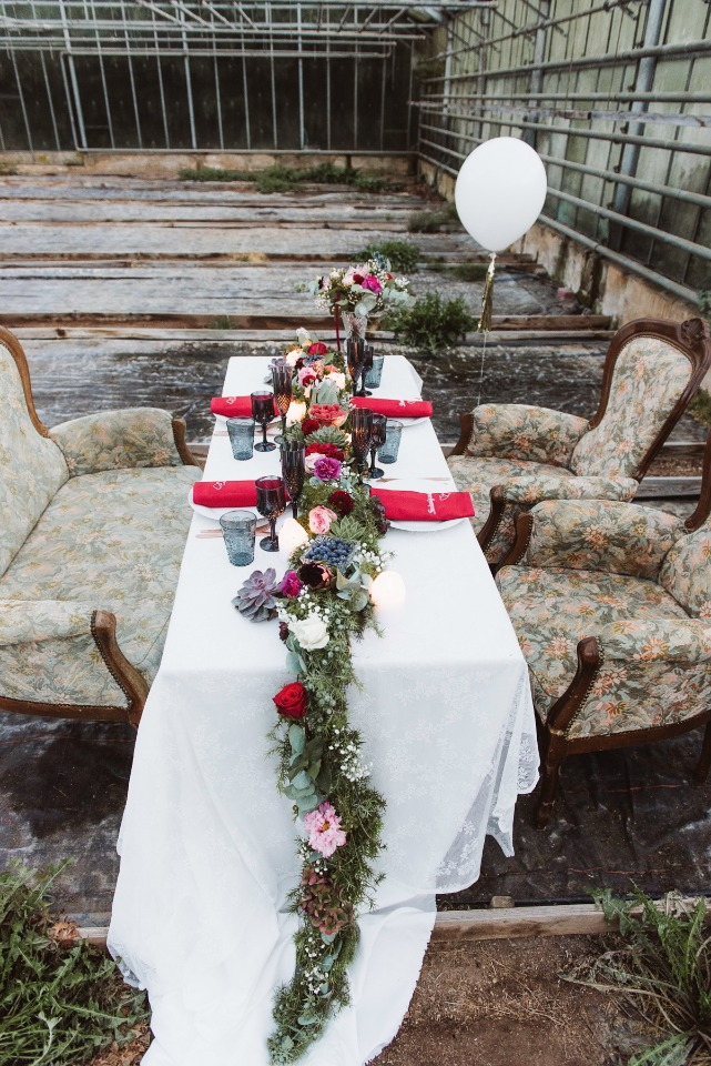 Pretty reception table with floral garland