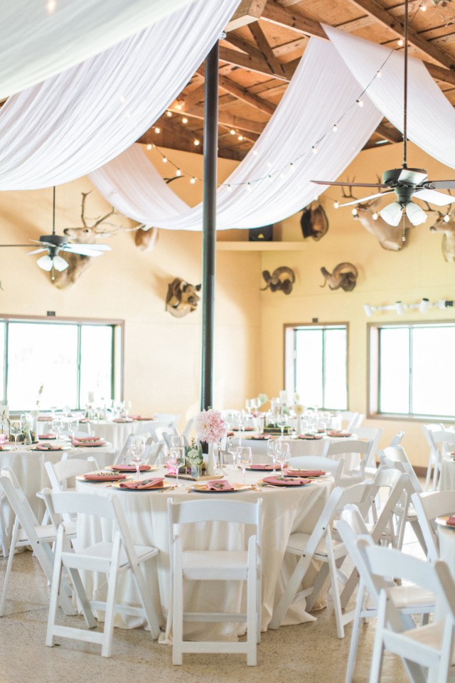 beautifully draped reception space with cafe lighting