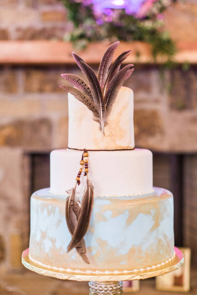 boho wedding cake with feathers