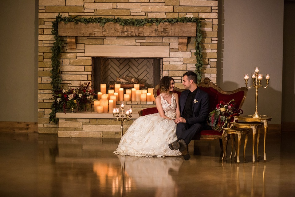 candle lit gold and red wedding decor
