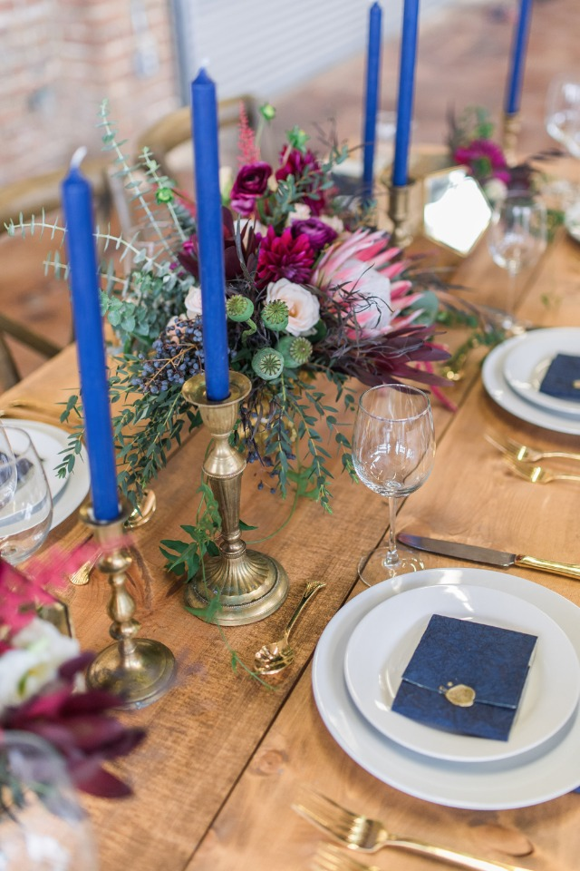 blue and gold and burgundy wedding table decor