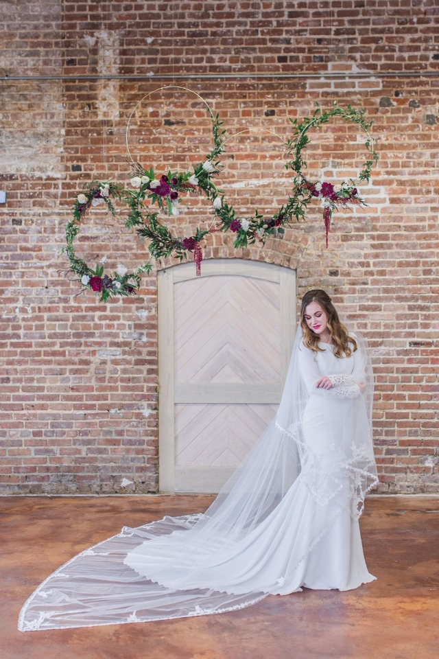 bride in cathedral veil and floating floral wreaths