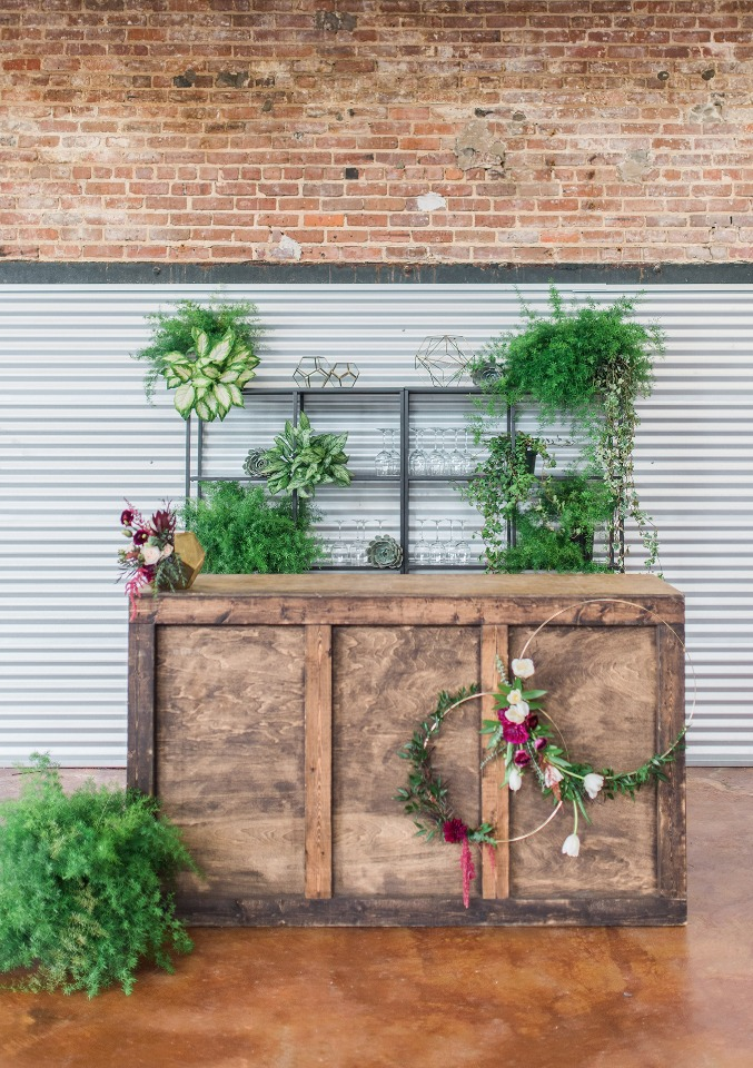 modern bar decked out in greenery