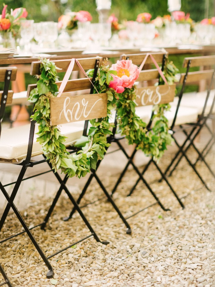 Sweetheart chairs with signs and garlands