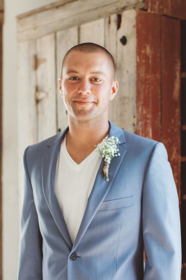 groom in v neck and dusty blue suit