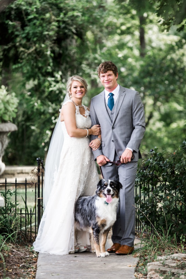Beautiful couple and their wedding pup
