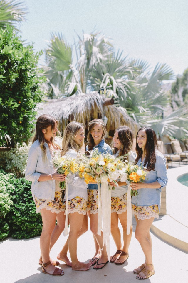 bride and her bridesmaids in getting ready outfits