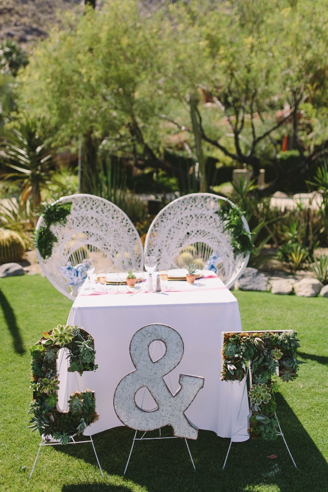 sweetheart wedding table with wicker thrones and succulent signs