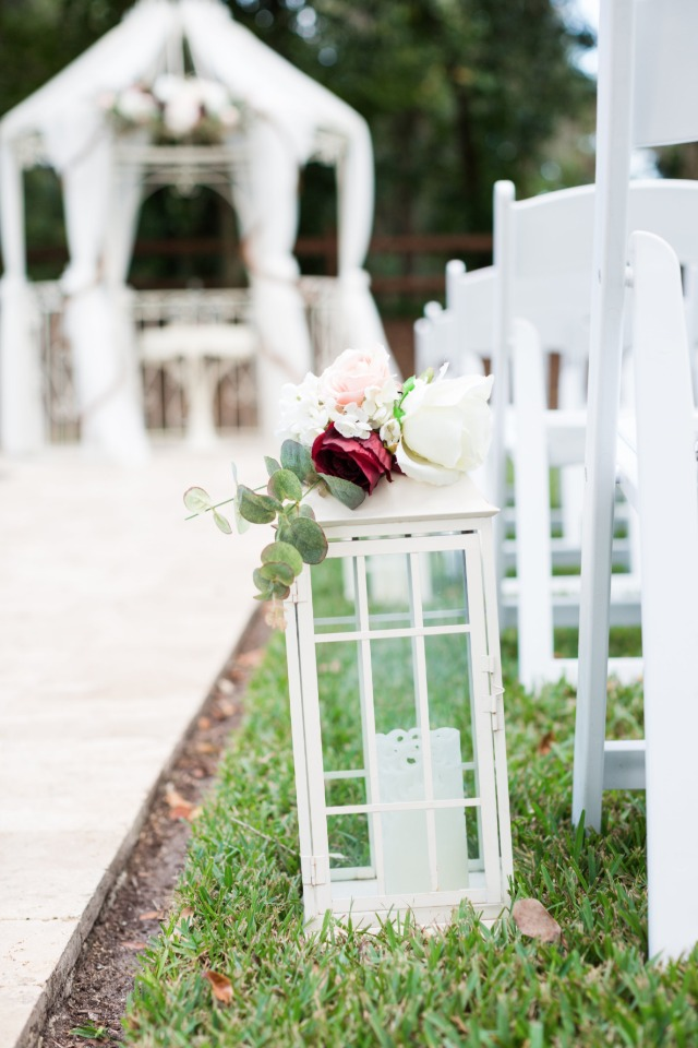 white flower topped lantern aisle decor