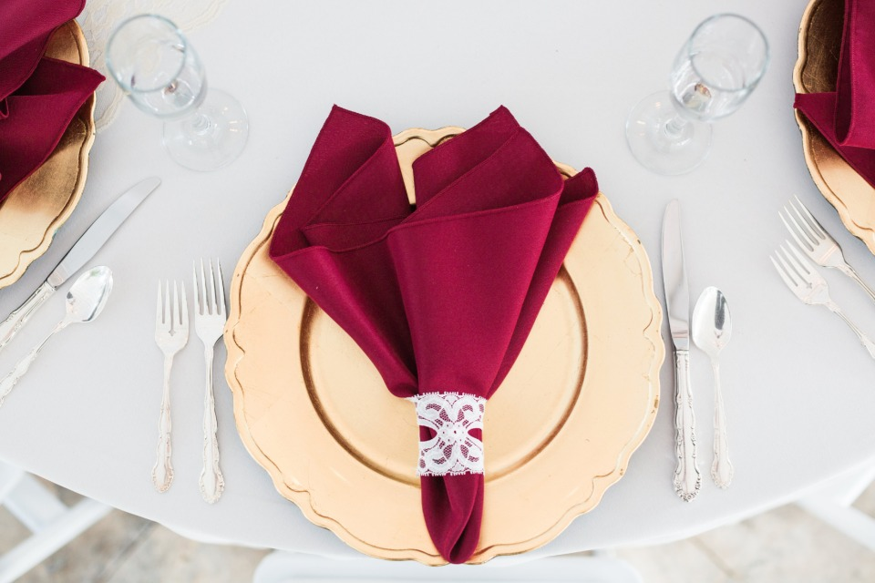 formal table setting for a gold and red wedding