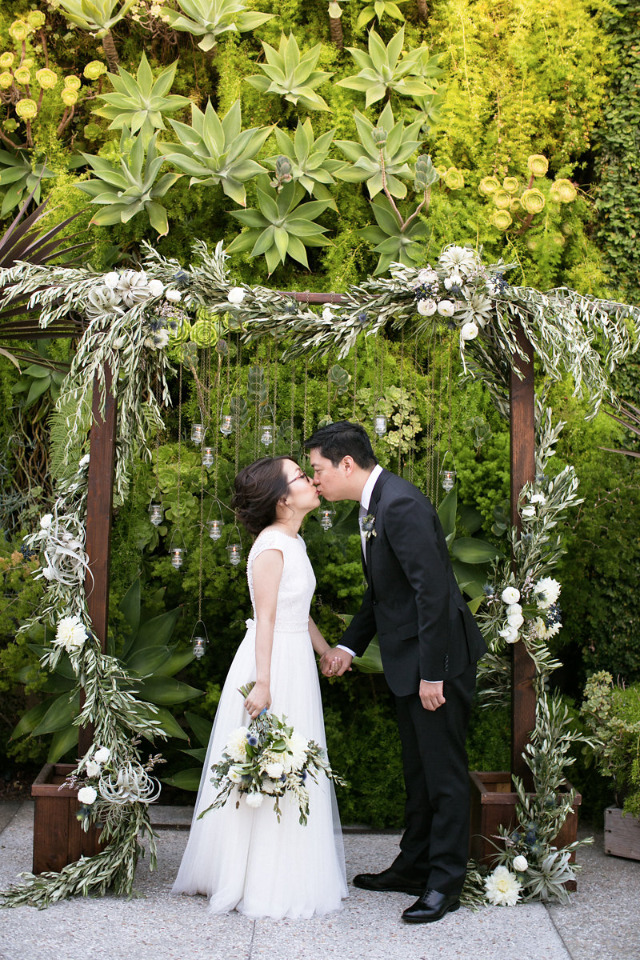 greenery and candle wedding ceremony arch