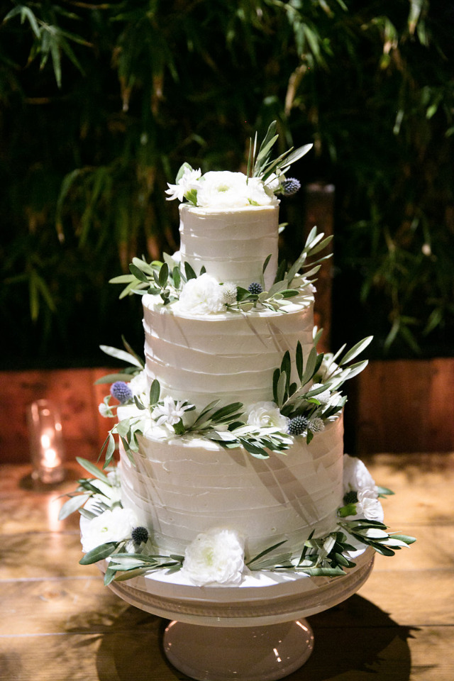 rustic white wedding cake with olive leaves