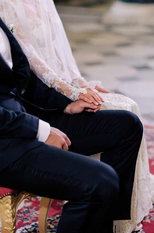 sweet hand holding bride and groom