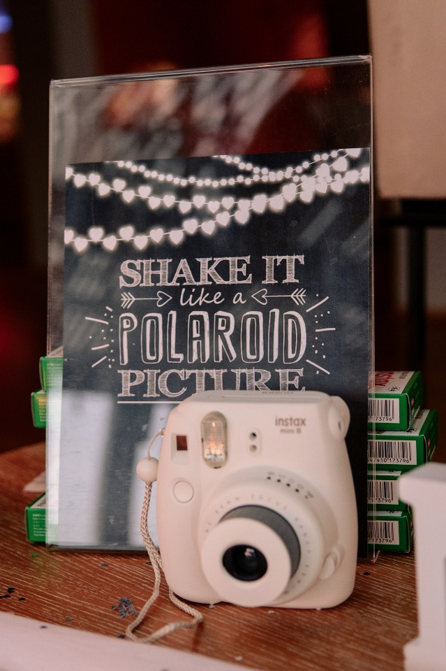 shake it like a polaroid picture sign