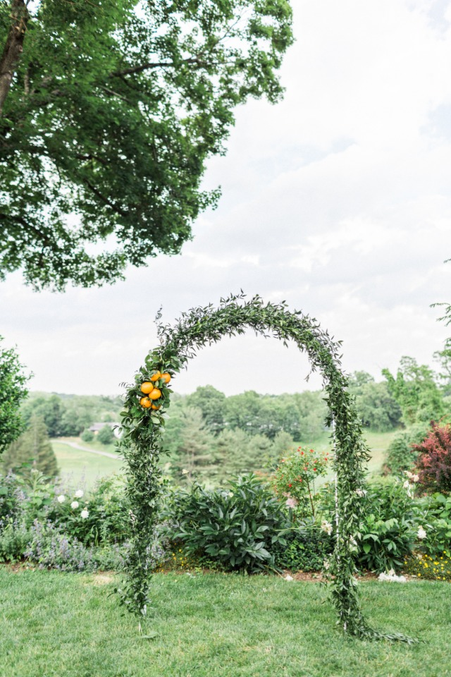 greenery and orange wedding arch