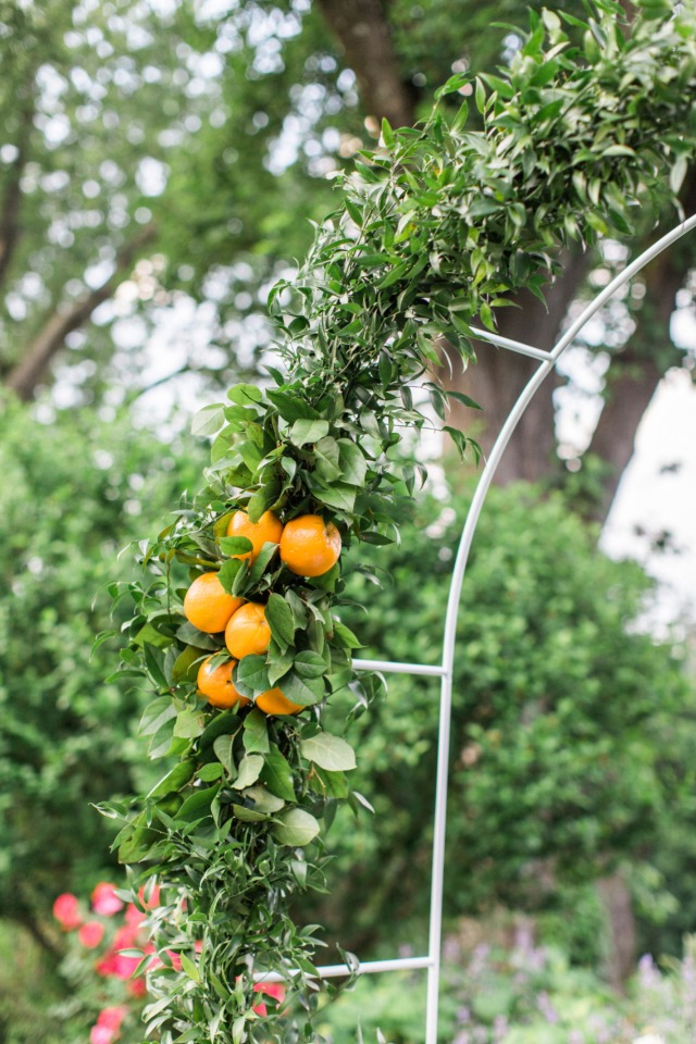 orange accents for your wedding arch