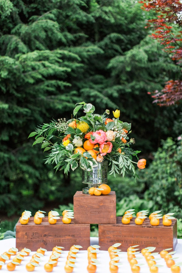 bright and cheery garden escort card display