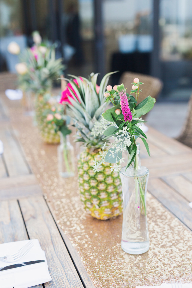 pineapple and bright flowers wedding centerpiece