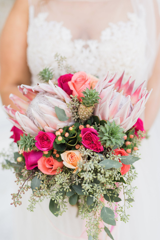 peach and pink rose and protea bouquet
