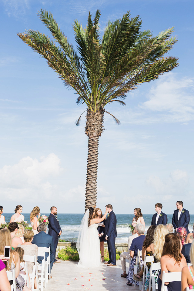 beach wedding with a palm tree backdrop