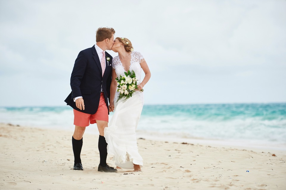 wedding kiss at Coral Beach Club