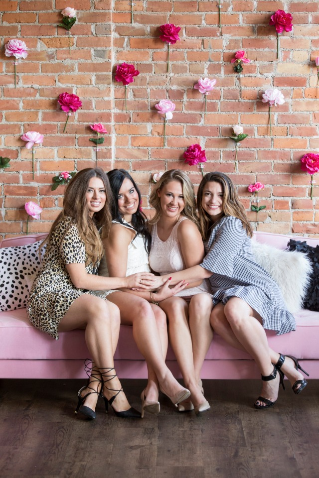 cute bridesmaid photo op on a pink couch