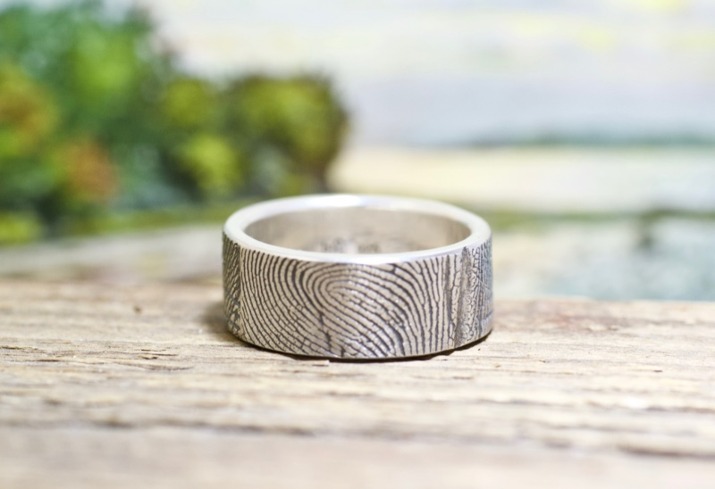 Wrapped around your finger! This ring features our wrapped fingerprint that is unique to us. This features your finger impression wrapped