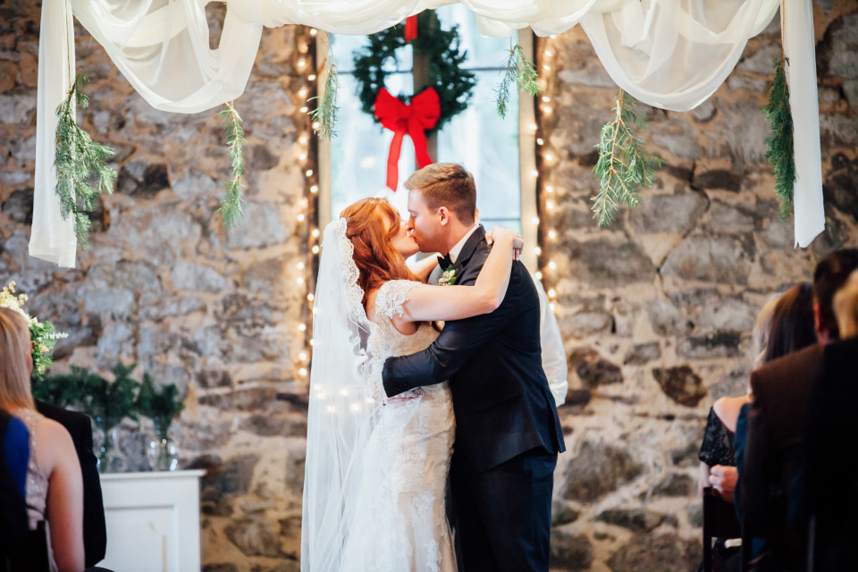 winter wedding ceremony kiss