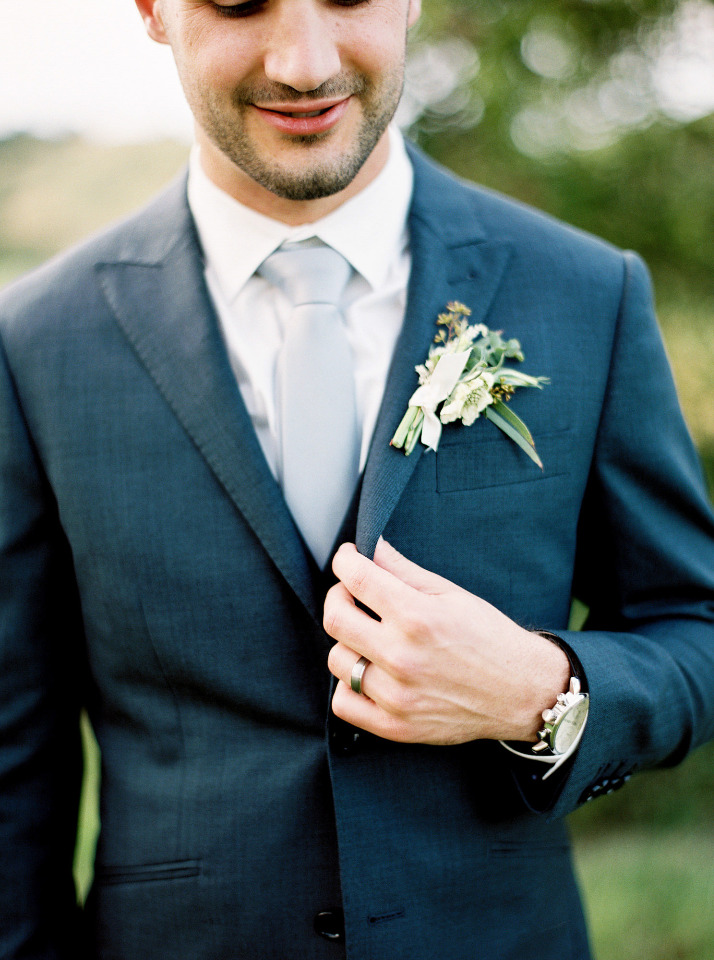 dark navy suit with light blue tie