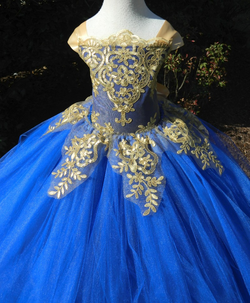A flower girl dress fit for royalty! Custom made. Comes in royal (as shown), emerald, pink, lavender or most any other color you