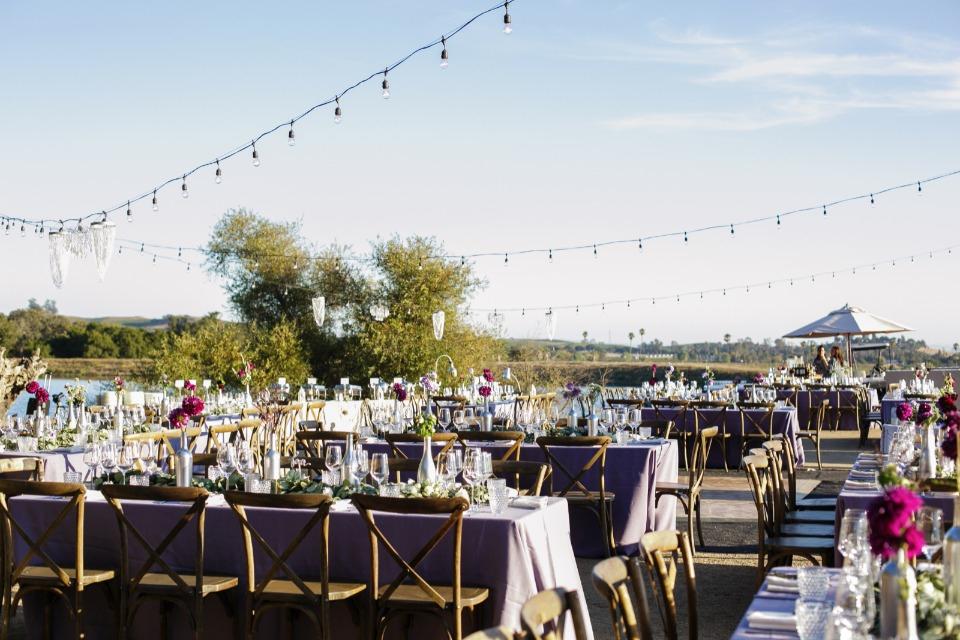 Stylish outdoor reception in jewel tones