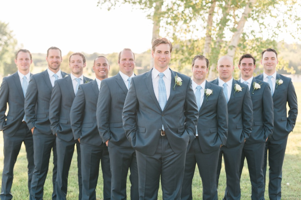 dapper looking groom and his groomsmen