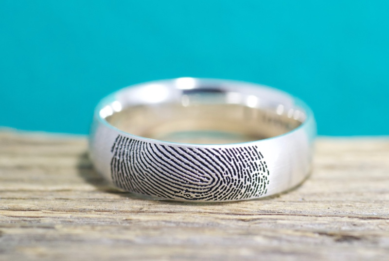 This traditionally styled fingerprint ring is a handcrafted, one of a kind, personalized work of art. Made exclusively for you with