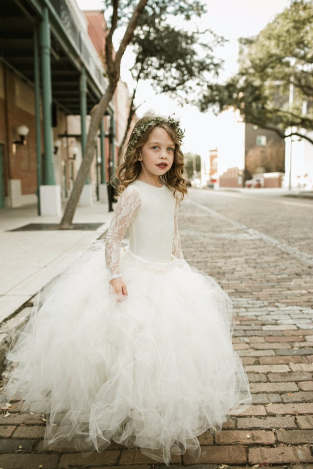 beautiful flower girl in tulle and lace dress