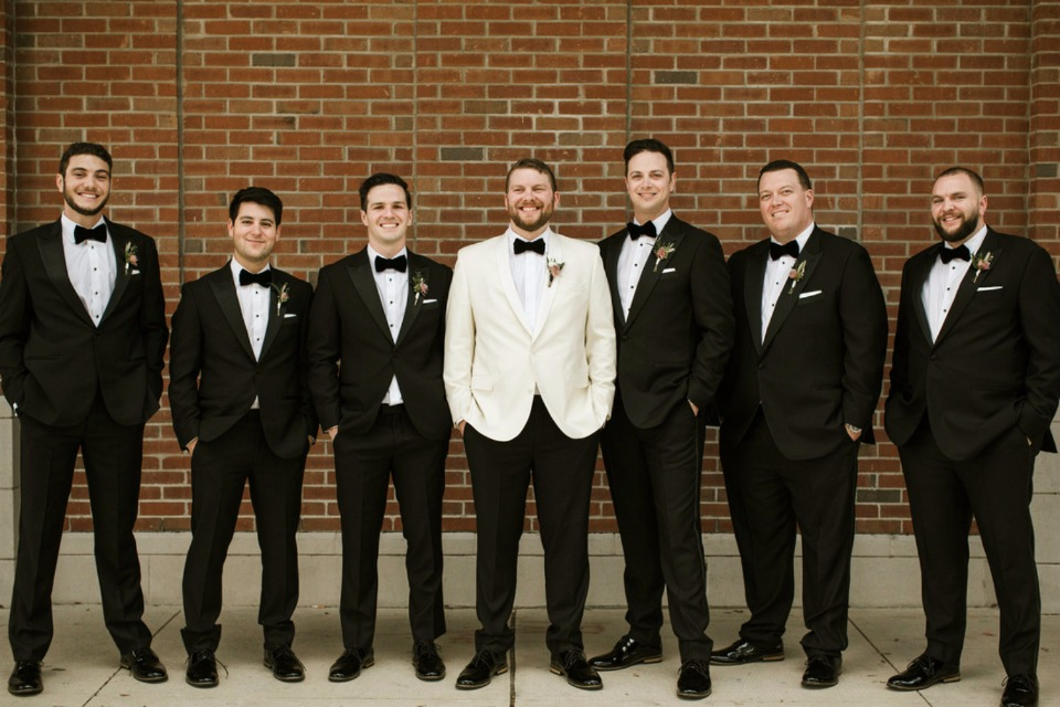 black and white groom and his men