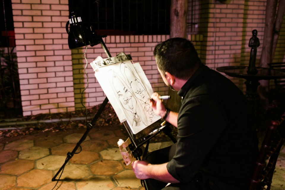 caricature artist instead of a photo booth