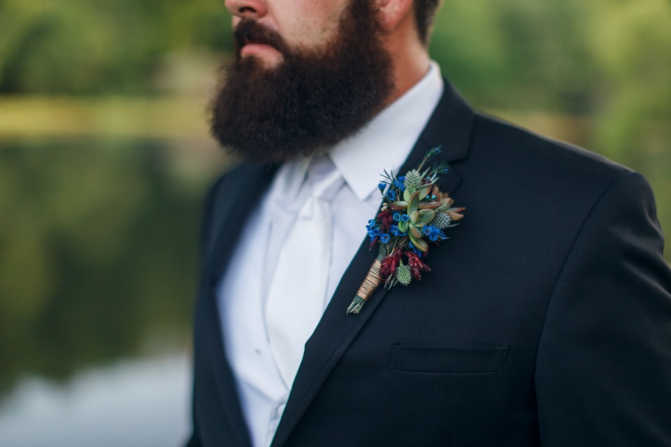 white and black groom style colorful boutonniere