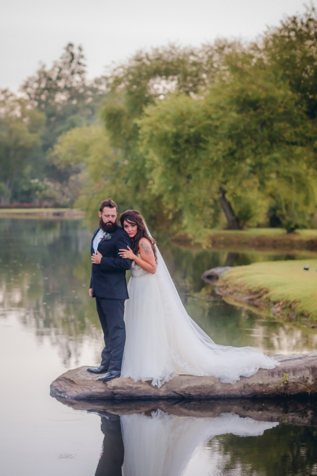 Romantic pond side wedding portraits
