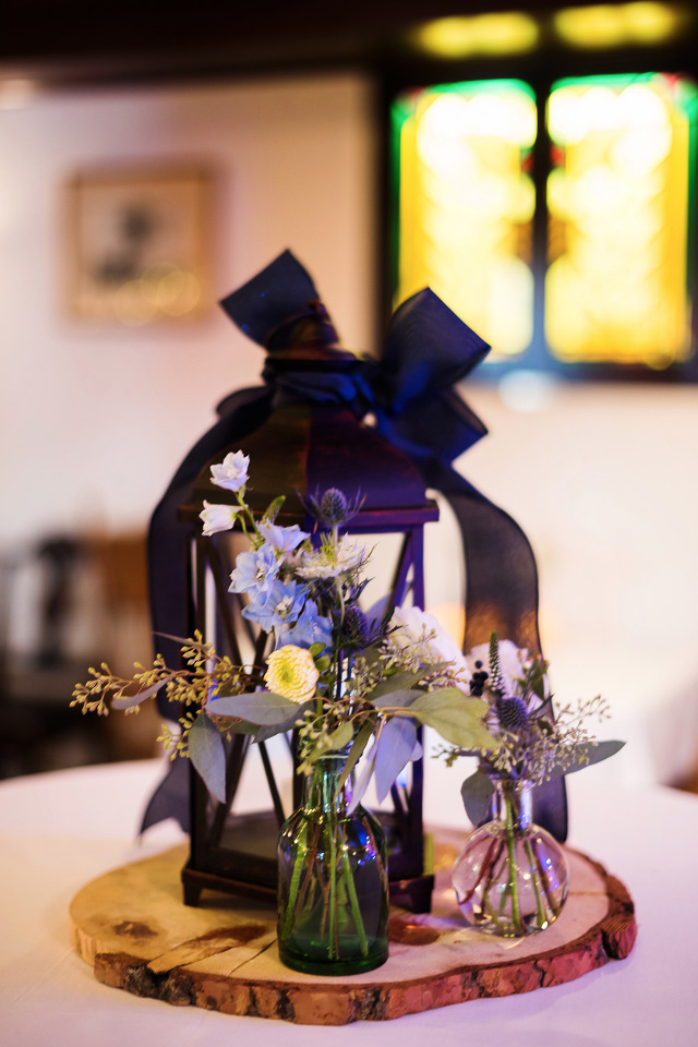 lantern and flower wedding centerpiece