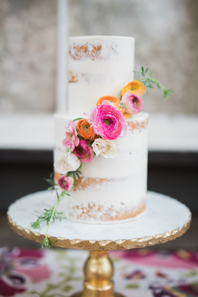 half naked wedding cake with floral cascade