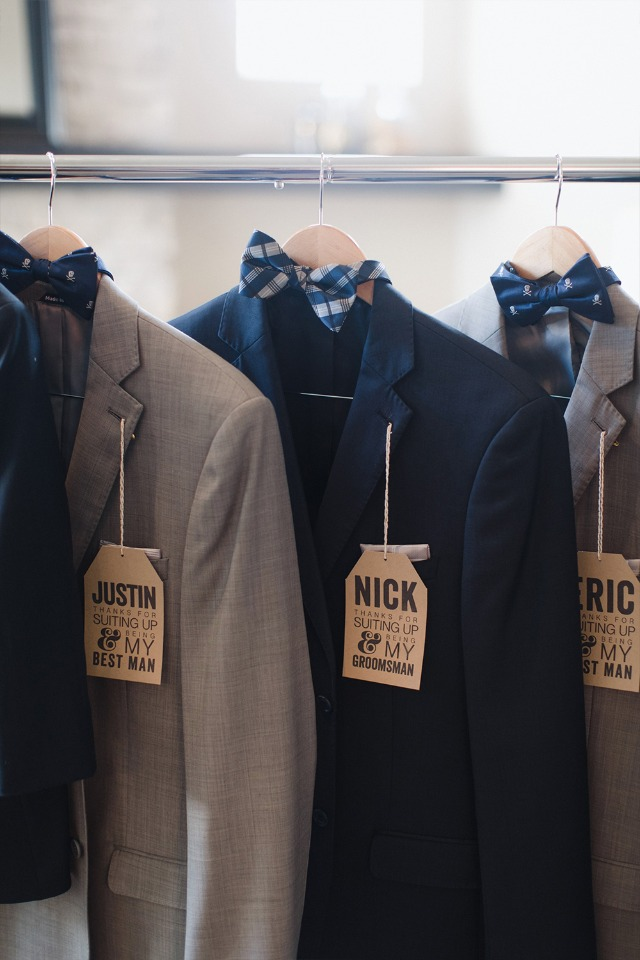 Groomsmen suits hanging up from Generation Tux