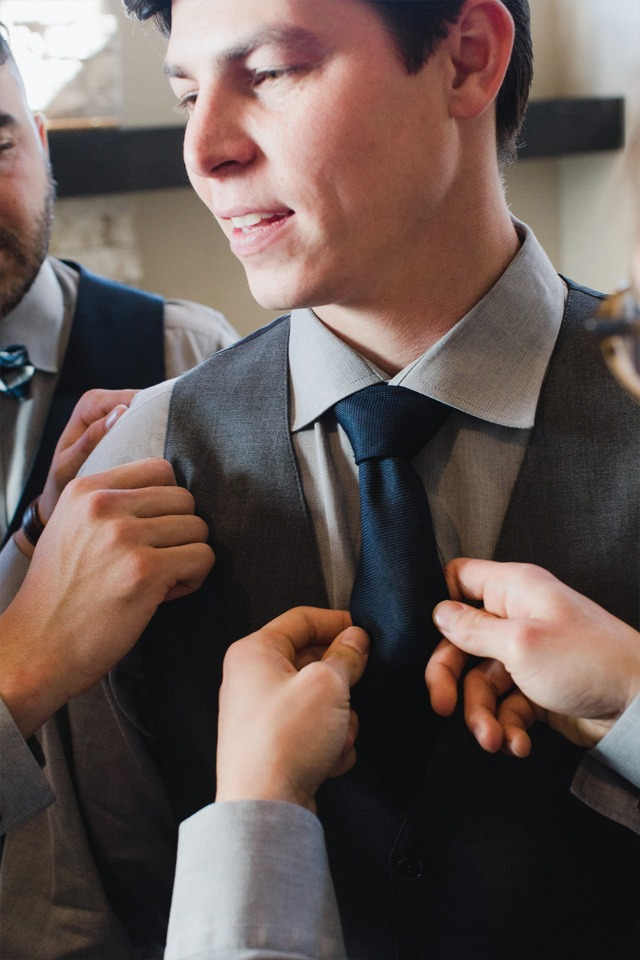 Groomsmen getting ready in their Generation Tux suits
