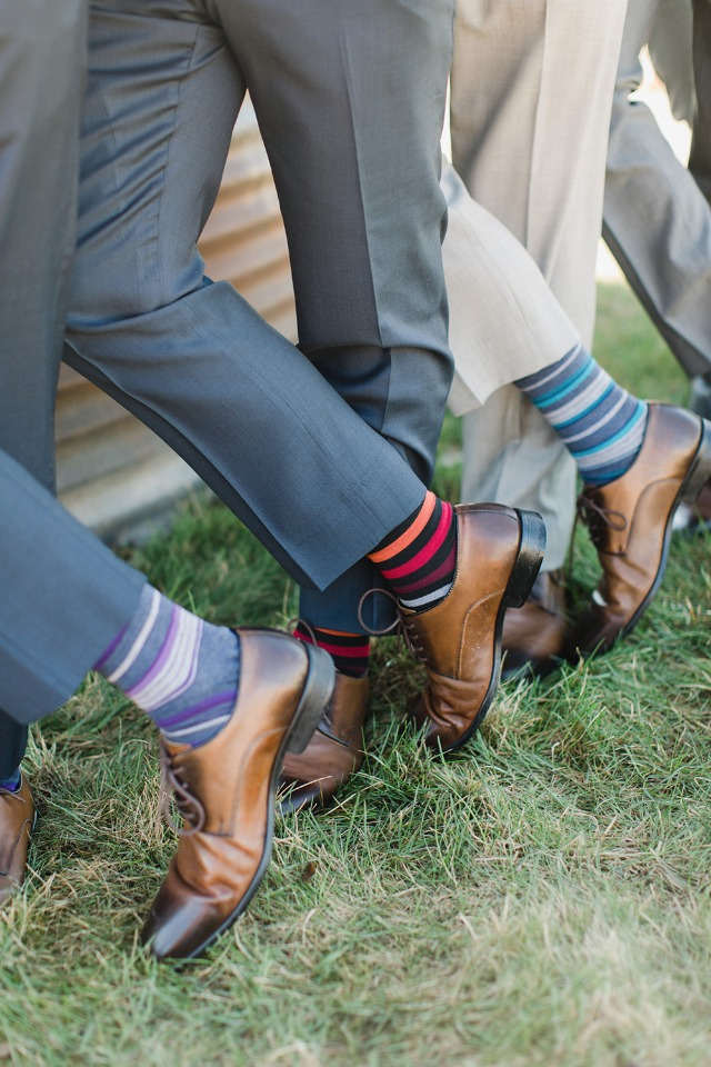 Groomsmen in their mis-mtached socks