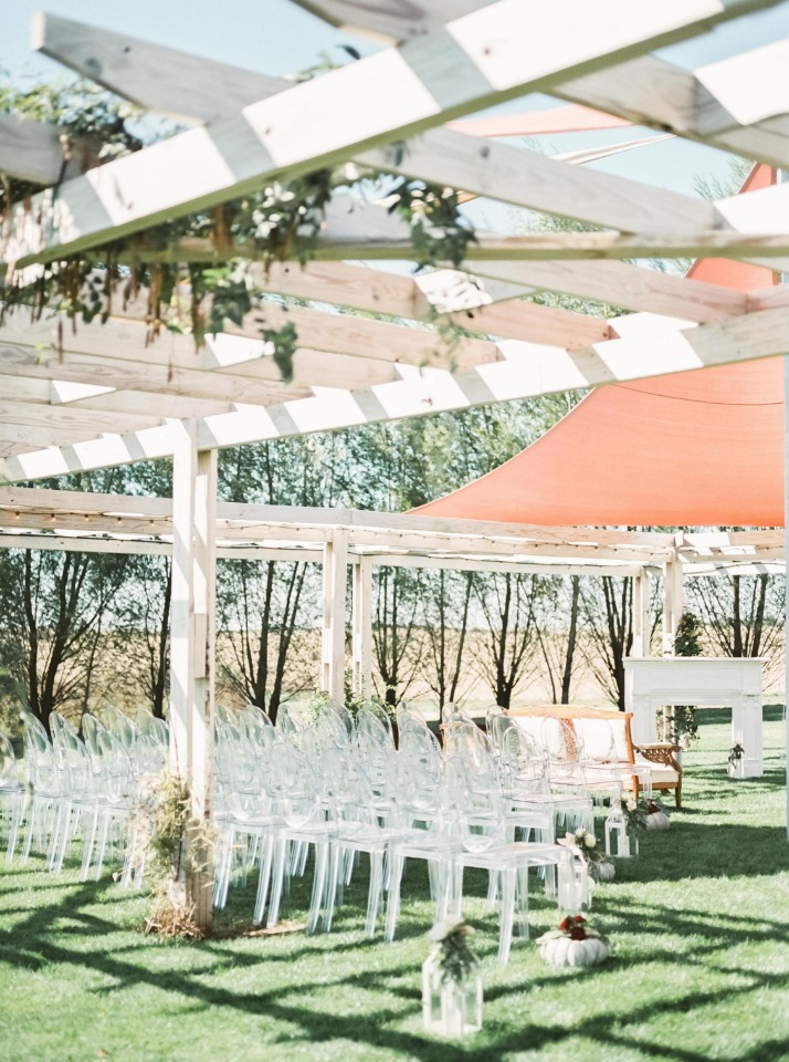 Clear chairs for an outdoor ceremony