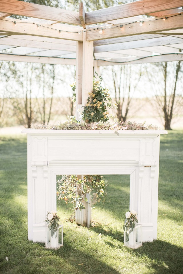 Vintage fireplace mantle ceremony backdrop