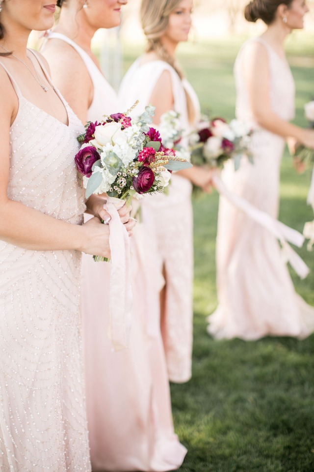 Blush dresses and burgundy flowers