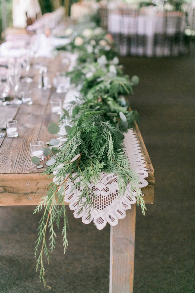 Mixed greenery with lace runner