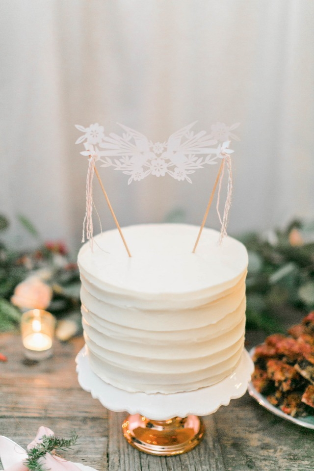 Simple white wedding cake with banner